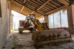 Photograph of a scraper parked in the farmhouse Royalty Free Stock Photos