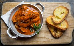 Cajun Prawns with Garlic Toast. Photograph of a cajun prawn dish with garlic toast stock photos
