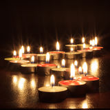 Photograph of candles on black background Royalty Free Stock Images