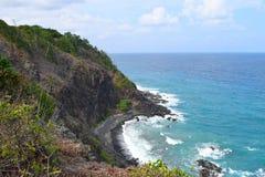 Fraught with Danger - Brae with Steep Hillsides into Blue Ocean below - Chidiya Tapu, Port Blair, Andaman Nicobar, India royalty free stock images