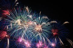 Colourful fireworks in the night sky over city stock photography