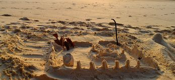 Sand Art & Play - Miniature Castle Building with Pillars and Canal on Sea Shore - Creative and Fun for Kids stock images