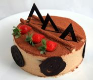 Photograph of chocolate charlotte mousse cake. Pastry Stock Images