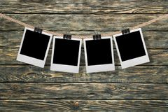 Photograph. Clothesline instant camera five objects clothespin rope single line Stock Photo