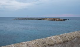 Photograph of coastline in the town of Gallipoli in the Salento Peninsula, Puglia, Southern Italy. Gallii Italy. Photograph of coastline in the town of Gallii royalty free stock photo
