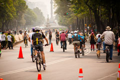 Photograph of cyclists at Mexico City. Angel behind Royalty Free Stock Photo