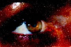 A photograph with a double exposure, the eye looking from the depths of the galaxy into the infinite space of the cosmos Royalty Free Stock Photos