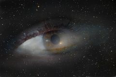A photograph with a double exposure, the eye looking from the depths of the galaxy into the infinite space of the cosmos. Stock Photography