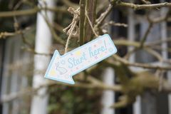 Easter Egg hunt wooden colorful sign with bunny royalty free stock images