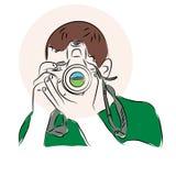 photograph Ein Mann mit einer Kamera in seinen Händen lizenzfreie abbildung