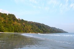 Green Forest Hills, Blue Sky and Picturesque Serene Secluded Beach - Radhanagar Beach, Havelock Island, Andaman & Nicobar, India. This is a photograph of the royalty free stock photo