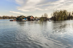 Photograph Of Flooded Land With Floating Houses At Sava River - Belgrade - Serbia. Early spring photograph, made at New Belgrade's Block 45 river promenade Royalty Free Stock Images