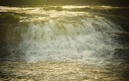 Forceful Flow of Water with Bright Sunlight - Flood - Natural Aqua Background Royalty Free Stock Photo