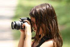 Photograph girl. Photograph in action in the forest Royalty Free Stock Photos