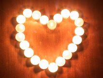 Photograph of heart candles on black background Royalty Free Stock Photos