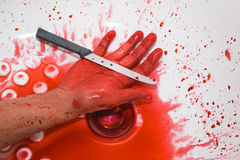 Photograph of a knife and it's full with blood Royalty Free Stock Photography