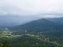 A Town in Valley among Mountains with Clouds in Sky - Natural Monsoon Landscape Royalty Free Stock Photos