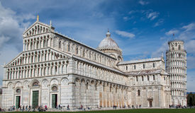A photograph of the Leaning Tower of Pisa and the Cathedral. The picture taken a warm spring day a before the peak of the tourist season Royalty Free Stock Photos