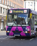 Photograph of a learner bus driver. A new Learner Bus Driver in training in a special driver training bus royalty free stock images