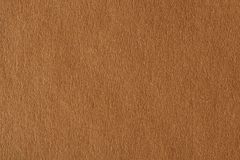 Photograph of light brown paper. stock images