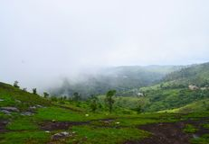 Misty Green Hills in Western Ghats - Peerumedu, Idukki District, Kerala, India - Natural Background Stock Image