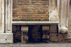 Photograph of an old stone bench. Royalty Free Stock Photo