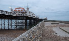 Photograph of Palace Pier, Brighton, Sussex UK, with jetty on right royalty free stock photography