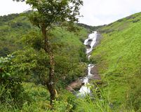Palozhukum Para Waterfalls with Green Hills - Vagamon Falls, Idukki, Kerala, India Stock Photo