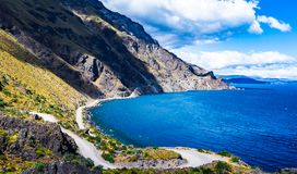 Incredible landscape of the Austral highway. Photograph of `Paso Las Llaves` with the southern chile highway bordering General Carrera Lake. Region of Aysen royalty free stock photo