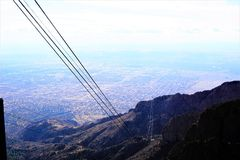 Sandia Peak Tram in New Mexico. A photograph from the peak of the Sandia mountains in New Mexico showing the city of Albuquerque below Stock Photos