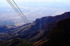 Sandia Peak Tram in New Mexico. A photograph from the peak of the Sandia mountains in New Mexico showing the city of Albuquerque below Stock Image