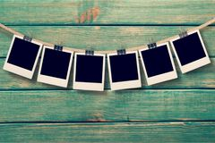 Photograph. Clothesline instant camera five objects clothespin rope single line Royalty Free Stock Images