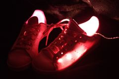 Photograph of pink walking shoes stock photography