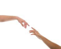 Photograph of a reaching hands together. Isolated on white background Stock Photography