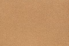 Photograph of Recycle Coarse Grain Striped Brown Kraft Paper Grunge Texture.  Stock Photos