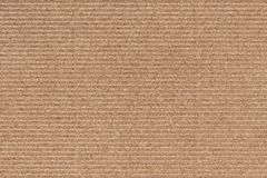 Photograph of Recycle Coarse Grain Striped Brown Kraft Paper Grunge Texture.  Royalty Free Stock Photo