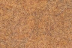 Photograph of Recycle Coarse Grain Striped Brown Kraft Paper Mottled Grunge Texture.  Royalty Free Stock Photo