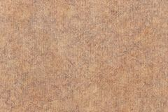 Photograph of Recycle Coarse Grain Striped Brown Kraft Paper Mottled Grunge Texture.  stock photos