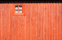 Photograph of a red wooden wall with window Royalty Free Stock Photos