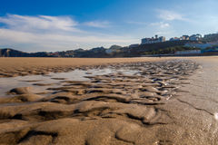 Comillas beach. Photograph of sandy Comillas beach in Cantábria, Spain Royalty Free Stock Photo