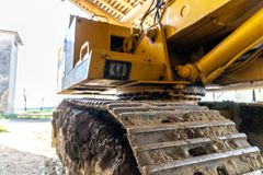 Photograph of a scraper parked in the farmhouse Royalty Free Stock Image