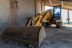 Photograph of a scraper parked in the farmhouse Stock Photography