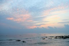 Colors of Sunrise in Sky at Stony Beach - Kalapathar beach, Havelock Island, Andaman Nicobar Islands, India. This is a photograph of serene, calm and peaceful stock images
