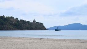 Serene Seascape with Still Bue Waters, Sandy Beach, Trees, and Clear Sky - Chidiya Tapu, Port Blair, Andaman Nicobar island, India. This is a photograph of royalty free stock photo