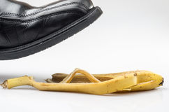 Domestic accident. Photograph of a shoe before slipping on a banana peel on the floor Royalty Free Stock Images