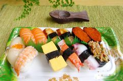 Assorted sushi take away platter. A photograph showing a colourful take out platter of Japanese traditional style cuisine of assortment of sushi. Types of sushi stock photography