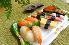 Assorted sushi take away platter. A photograph showing a colourful take out platter of Japanese traditional style cuisine of assortment of sushi. Types of sushi royalty free stock photography