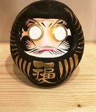 Traditional Japanese toy Daruma or Dharma. A photograph showing the cute little ancient tradition toy of Japan, the character Daruma or Dharma with large eyes royalty free stock photography