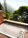 Outdoor bath room with view, tropical hill resort Royalty Free Stock Photography