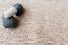 Pebbles and linen, zen textures background Stock Photo